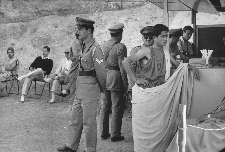 """Epidaurus. 1961. Theater festival. Interval during the play """"Medea"""" (Maria CALLAS in the main role). Costumes designed by the Greek painter TSAROUCHIS, on the left, arranging the actor's costume."""