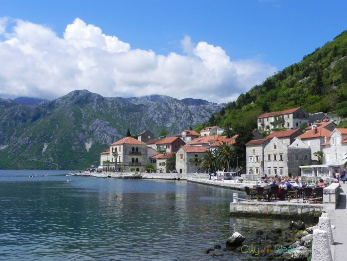 Perast stone houses surrounded by lush green hills
