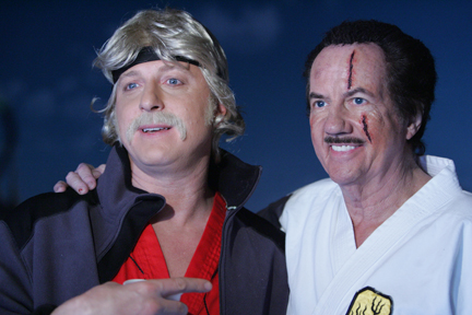 """Billy Zabka (""""The Karate Kid"""") and Bob Wall (reprising his O'Hara character) on the set of a commerical for TwinLab."""