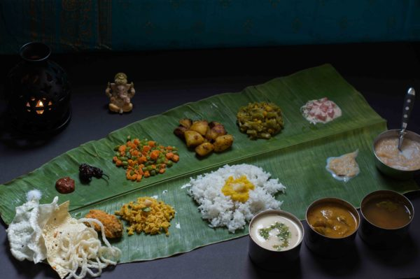 A traditional south indian meal served on a banana leaf.