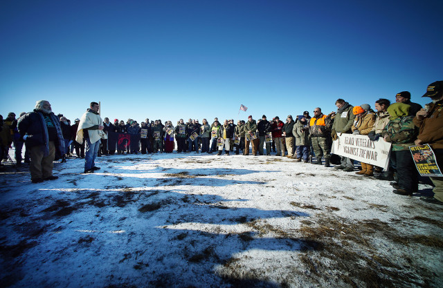 Scores of verterans and media gather by Standing Rock supporters with Congresswoman Tulsi Gabbard near Cannonball field, near the Standing Rock camp site. 4 dec 2016
