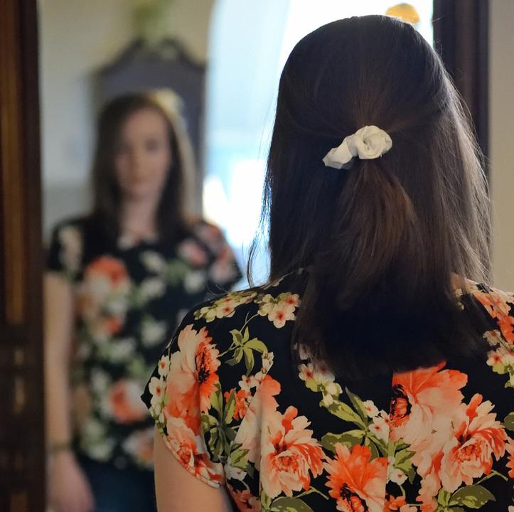 Woman looking in mirror, Claire Bulman Rapid Transformational Therapist