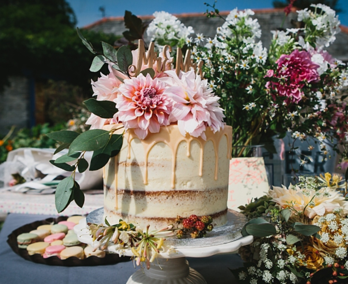 semi naked, single tier cake with fresh flowers