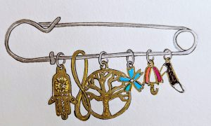 Symbolic charms hang from a safety pin