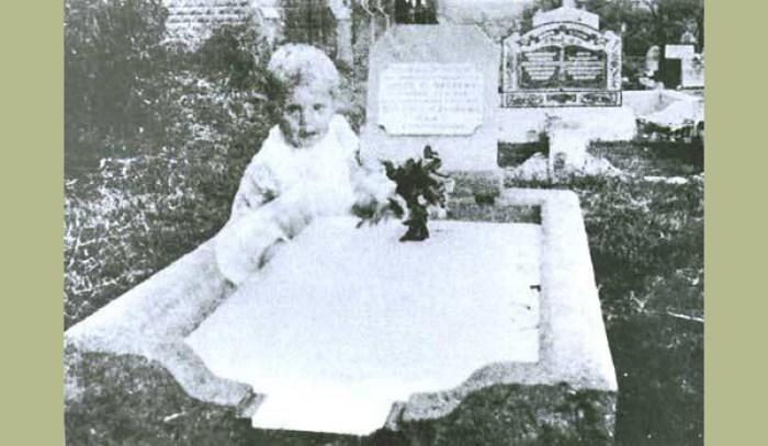 Ghost child at gravesite.