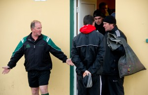 Referee Michael Talty meets with Doonbeg manager Ciaran O Neill and his men outside the dressing rooms at Kilmihil to discuss the county football quarter final. Photograph by John Kelly.