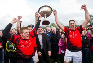 Whitegate's Michael Dooley, Raymond Cahill and team captain Brendan Bugler join forces to lift the cup following their win over Feakle in the Intermediate county final at Sixmilebridge. Photograph by John Kelly