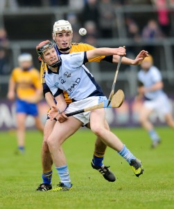 David Dempsey of Na Piarsaigh in action against John Fennessy of Sixmilebridge during the Munster Club Championship final at Cusack park. Photograph by John Kelly.