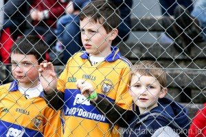 Clare fans Darragh Moroney (9), Liam Boyce (11) and Finn Boyce (7) watching their team in action at Cusack Park Ennis on Sunday. Photograph by Arthur Ellis.