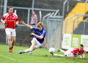 Cratloe's Podge Collins slots the ball past Eire Og's goalie Colin Smith during their Senior Football game at Cusack park Ennis on Saturday evening. Pic Arthur Ellis.