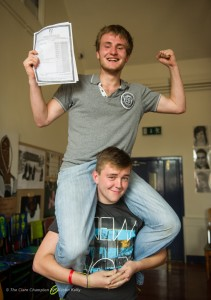 Tim Janson is lifted shoulder high by his friend Mark Kenny while meeting at Ennis Youth Centre for breakfast after Tim collected his results on Wednesday morning at the Ennis Youth Centre. Photograph by John Kelly.