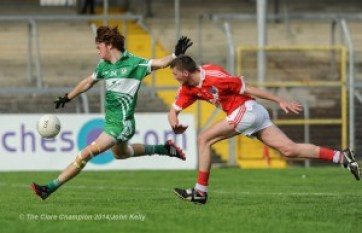Wolfe Tones Darragh Leahy scores a goal despite Corofin's Eoin Clancy during their Intermediate final in Cusack park. Photograph by John Kelly.