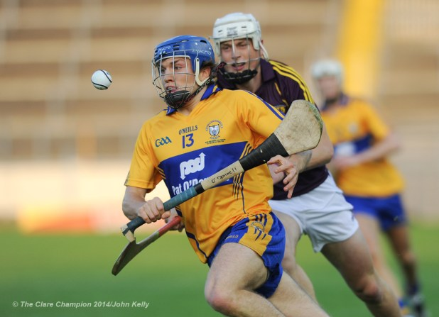 Shane O Donnell of Clare in action against Liam Ryan of Wexford during the All-Ireland U-21 final in Semple Stadium, Thurles. Photograph by John Kelly.