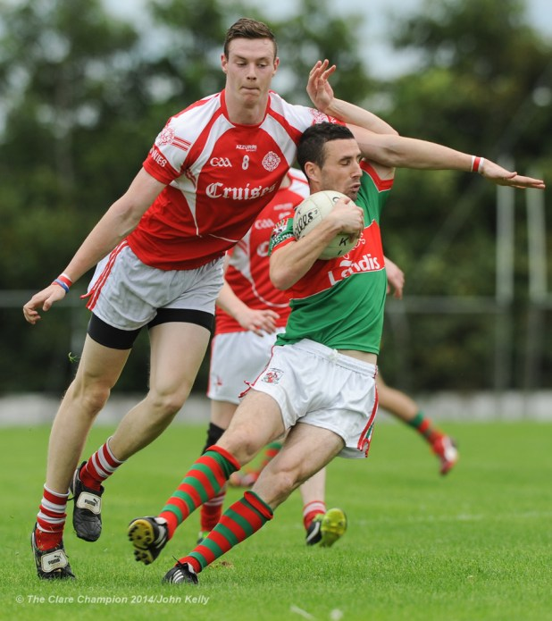 Darren O Neill of Eire Og in action against Shane Hickey of Kilmurry Ibrickane during their senior championship semi-final at Kilmihil. Photograph by John Kelly.