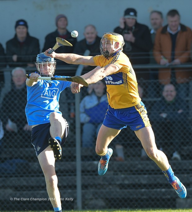 Niall Mc Morrow of Dublin in action against John Conlon of Clare during their NHL Division 1 Round 4 game in Cusack Park. Photograph by John Kelly.