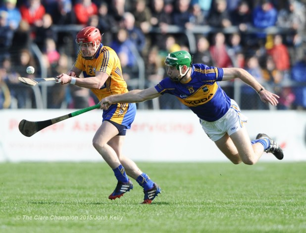 Paul Flanagan of Clare in action against Noel Mc Grath of Tipperary during their game in Cusack park. Photograph by John Kelly.