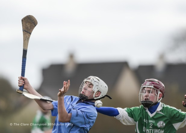 Shane Quinn Tuite of Scariff Community College  in action against Dean Lynch of Ennistymon CBS during their Munster U-15 D final at Clarecastle. Photograph by John Kelly.