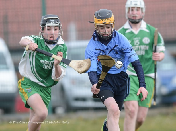 Aidan Sheedy of Scariff Community College  in action against Keelin Guiler of Ennistymon CBS during their Munster U-15 D final at Clarecastle. Photograph by John Kelly.