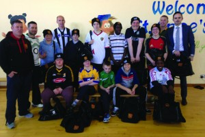 Students of St Anne's with their new gear from Ennis RFC's Donal McMahon and Tommy Lees of TTM Healthcare.
