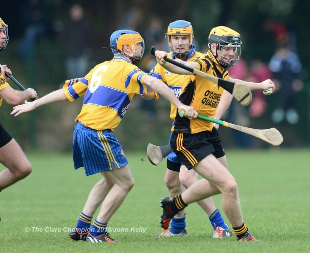 Kieran Murphy of Clonlara in action against Adrian Chaplin of Sixmilebridge during the Junior A final at Broadford.