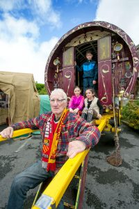 Edward McDonagh with 10-year-olds Diana and Brian McDonagh and eight- year-old Tracey Marie McDonagh at the Traveller site re-enactment. Photograph by Arthur Ellis.