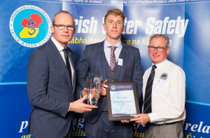 Simon Coveney TD, Minister for Housing, Planning & Local Government presents the Sports Persons of the Year Award to Bernard Cahill (22) from Ennis flanked by Seamus O'Neill, Chairman of the IWS Sports Commission at the annual Irish Water Safety Awards held at Dublin Castle.