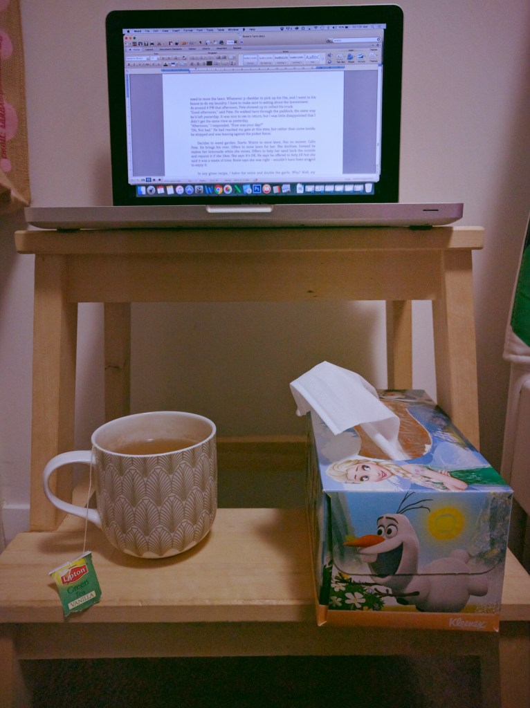 My dictating setup in the bedroom. Plenty of tea to keep my throat moist. (I apologise for using the word 'moist' - you didn't deserve that.)