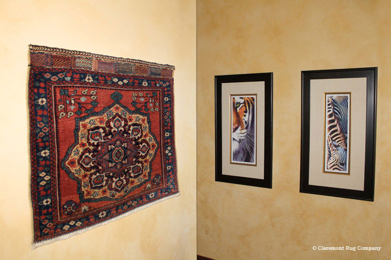 Tribal Persian Afshar Rug Is Paired With Photographs On Wall