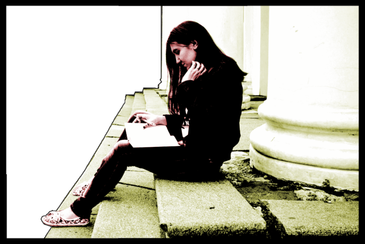 Woman reading on steps