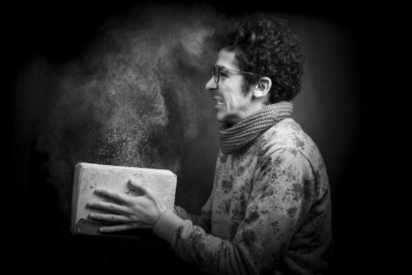 Frustrated man closing a book