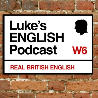 """Luke's English Podcast Logo: A London street sign with black text and """"real British English"""" in red at the bottom"""