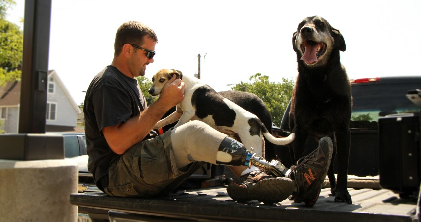 veteran with his dogs