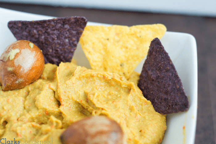 A zesty twist on guacamole -- roasted red pepper guacamole, made with sweet, red bell peppers, onions, garlic, and avocados. Perfect for parties.