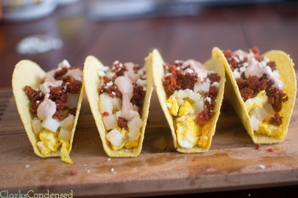 Spicy Breakfast Tacos: Filling and perfect for breakfast, these spicy breakfast tacos are filled with scrambled eggs, chorizo, potatoes o'brien, and a creamy sauce on top.