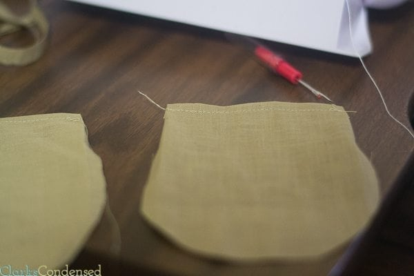 Sews over the Top of the Two Folded Edges