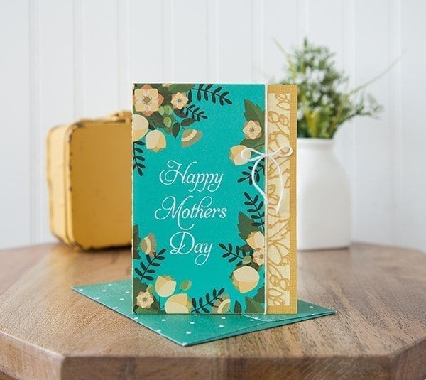 turquoise card with flowers.