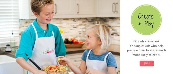 A boy and girl preparing food in a kitchen