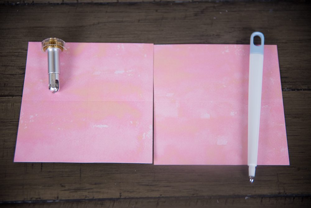 Closeup of a pink paper on table