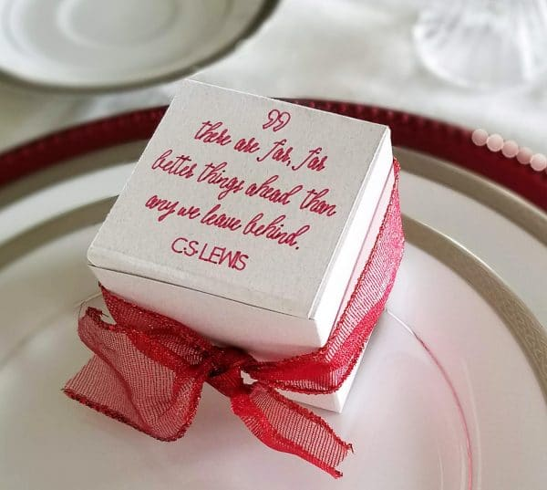A close up of a cake on a plate, with Party favor