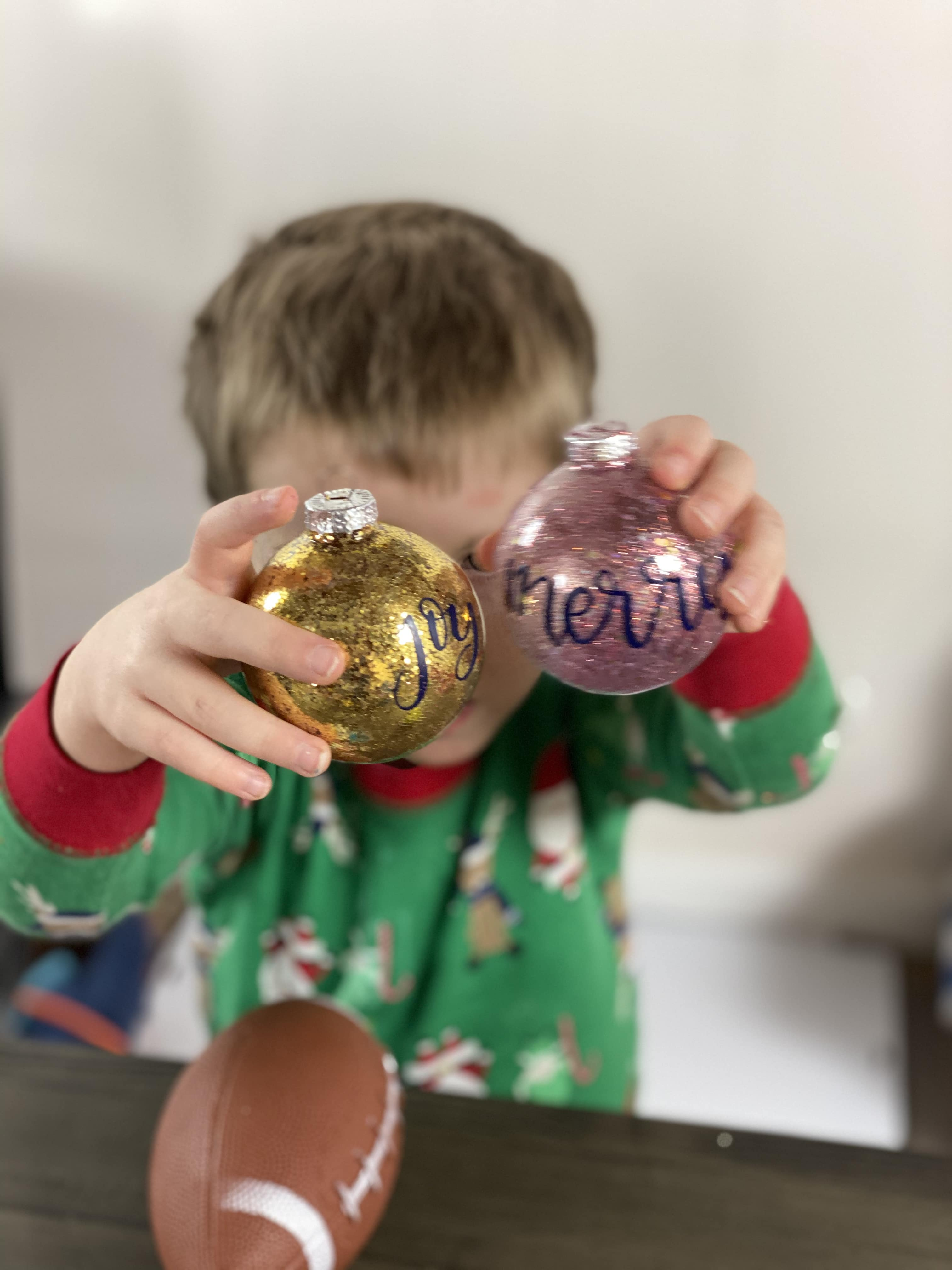 Christmas Glitter Ornament held by little boy