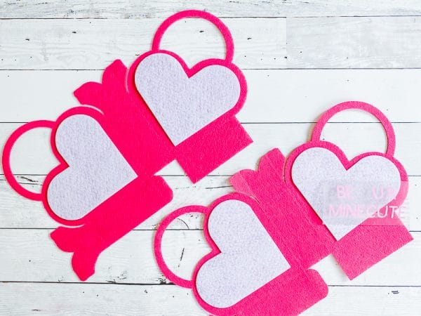 A close up of heart shaped pieces of paper DIY valentines