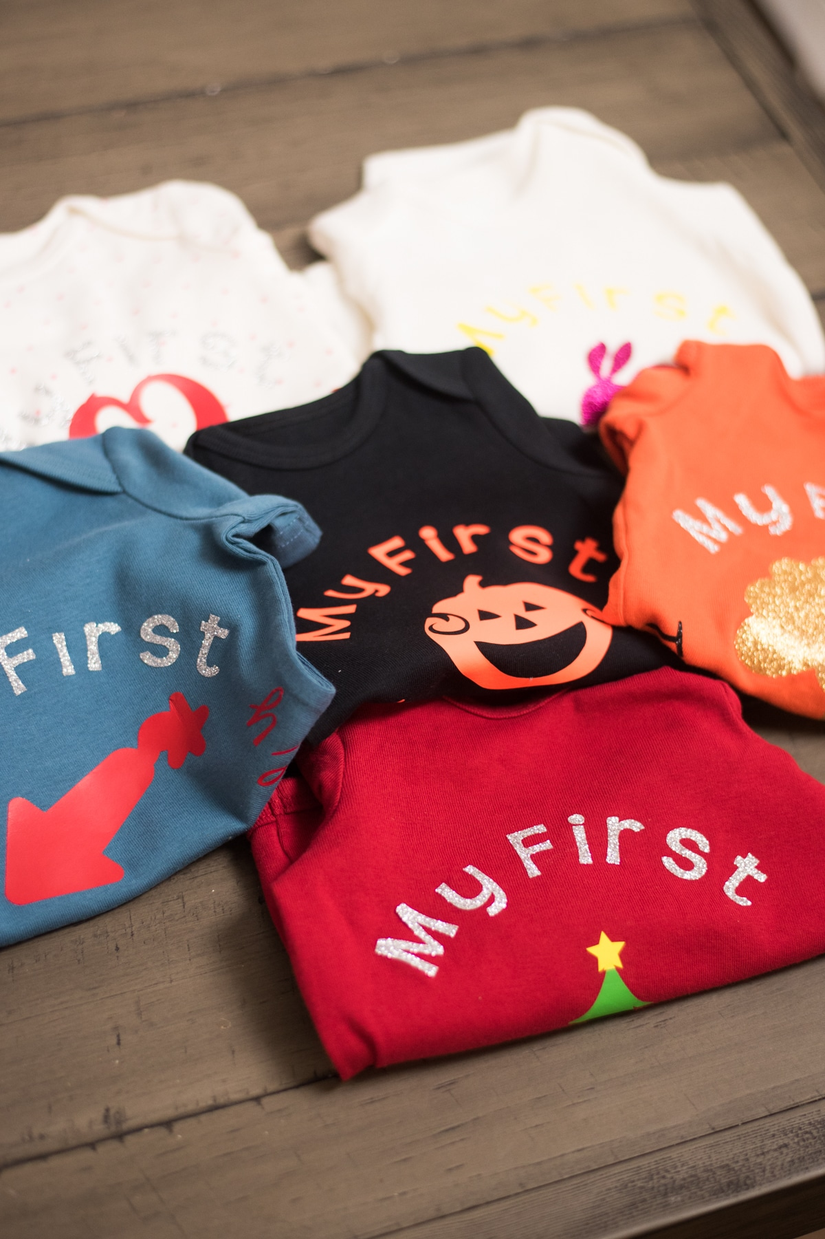 Blue, black, orange and red baby clothes