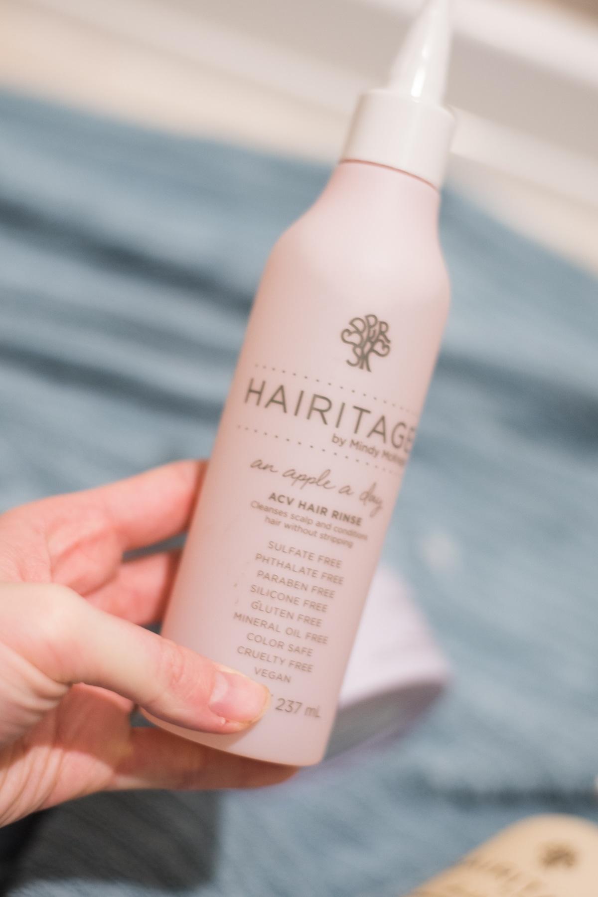 A close up of a shampoo bottle
