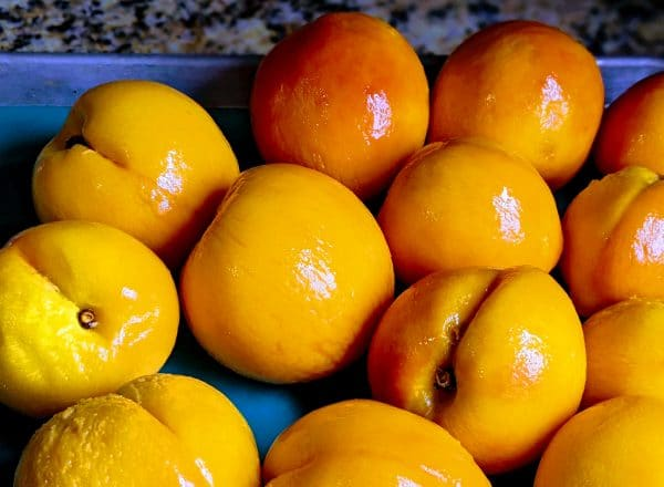 yellow peeled and washed peaches