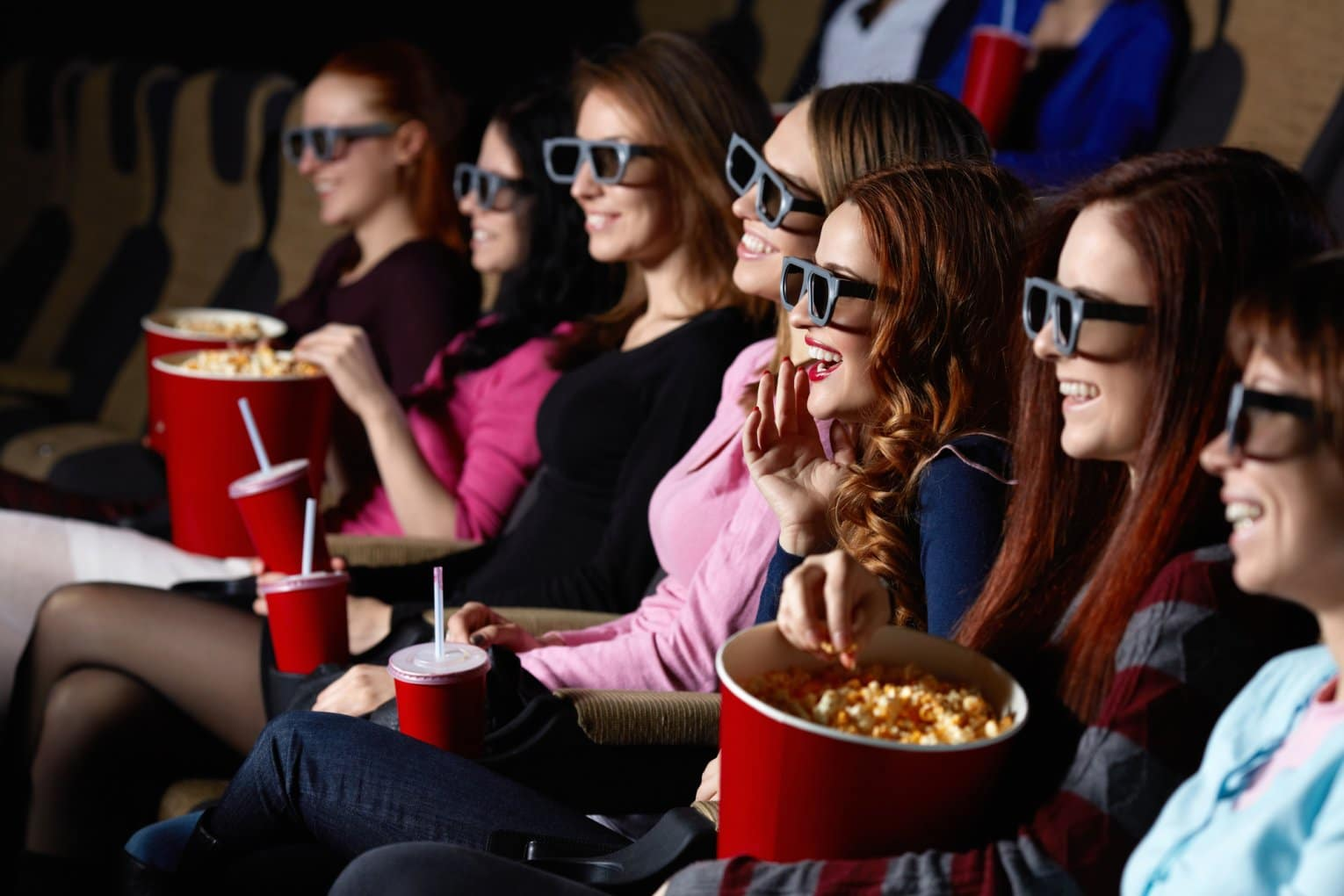 young adults watching movies with 3D glasses