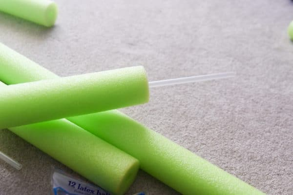 balloon stake through pool noodle