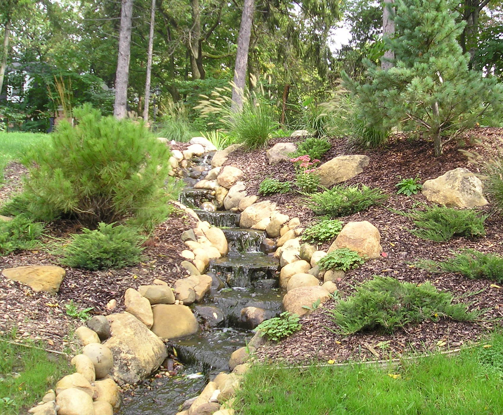 Water Features Clarks Landscape of Grand Rapids   Lawn ... on Backyard Stream Ideas id=31082