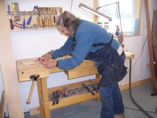 Sue working at the bench