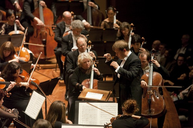Seattle Symphony music director Ludovic Morlot leads the orchestra (Photo: Ben VanHouten)