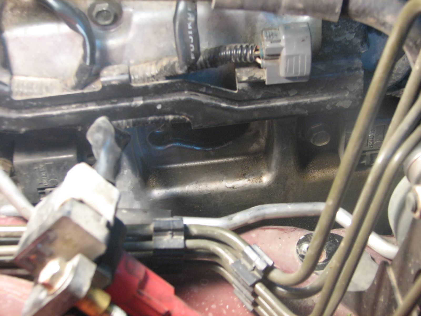 2002 Subaru Outback H6 30 Spark Plug Installation Classic Cars 2000 Pcv Valve Location Below This Is The Drivers Side Bottom Of Cover Notice Oil Drops Hanging From It These Little Drip Onto Exhaust Pipe And